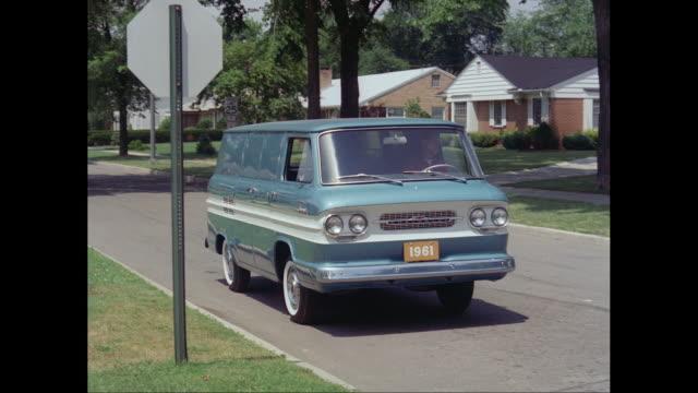 ws pan man driving 1661s chevrolet van on road / united states - シボレー点の映像素材/bロール