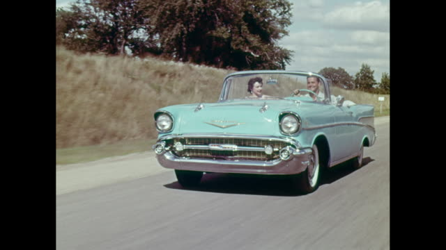 WS POV Man driving 1957 Chevrolet car on road / United States
