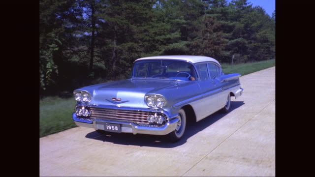 ms ts man driving 1958 car on road / united states - vintage car stock videos & royalty-free footage