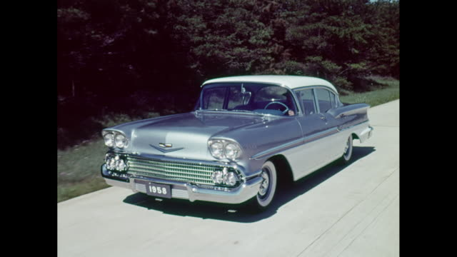 stockvideo's en b-roll-footage met  ws ts man driving 1958 chevrolet convertible car on road / united states - chevrolet