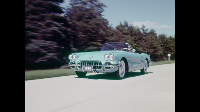 ws ts man driving 1958 chevrolet corvette on road / united states - horseless carriage stock videos & royalty-free footage