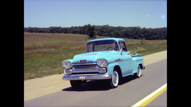 ws ts man driving 1958 chevrolet pick-up truck on road / united states - chevrolet truck stock videos & royalty-free footage