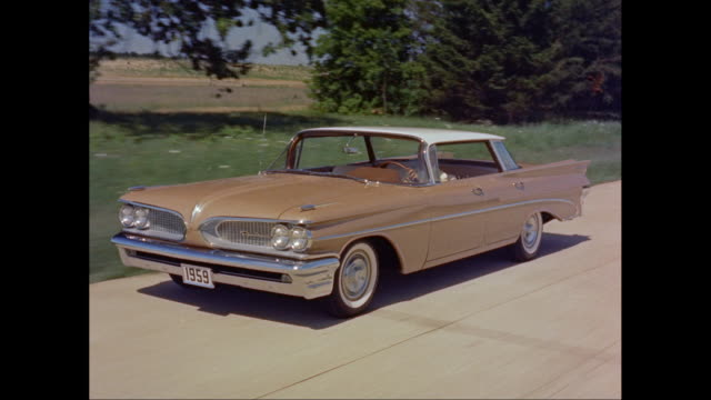 ms ts man driving 1959s chevrolet on road / united states - chevrolet stock videos & royalty-free footage