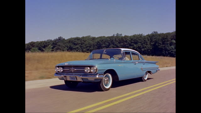 ws ts man driving 1960s chevrolet car on road / united states - chevrolet stock videos & royalty-free footage