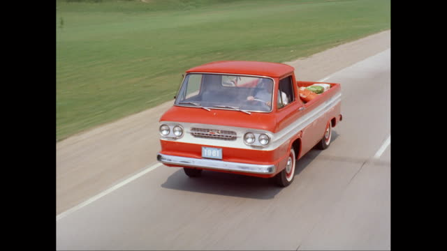 ms ts man driving 1961 chevrolet corvair pick up truck on road / united states - chevrolet stock videos & royalty-free footage