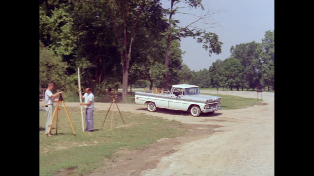 ws ts man driving 1961 chevrolet corvair pick up truck on road / united states - country road stock videos & royalty-free footage