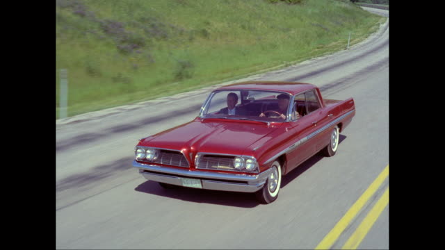ms ts ha man driving 1961 pontiac car on road / united states - pontiac stock videos and b-roll footage