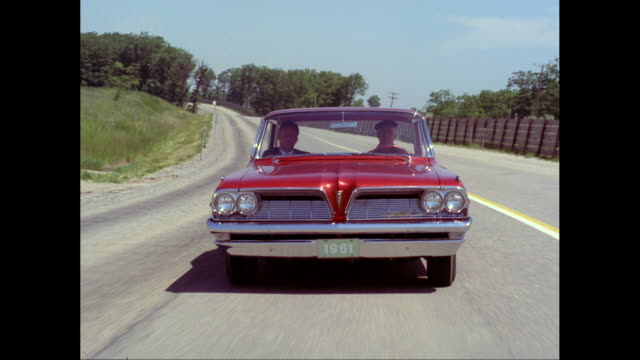 ms pov man driving 1961 pontiac car on road / united states - pontiac stock videos and b-roll footage