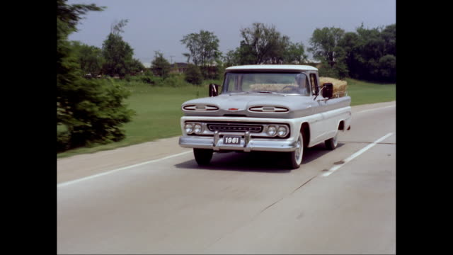 ms ts man driving 1961s chevrolet pick-up truck on road / united states - chevrolet stock videos & royalty-free footage