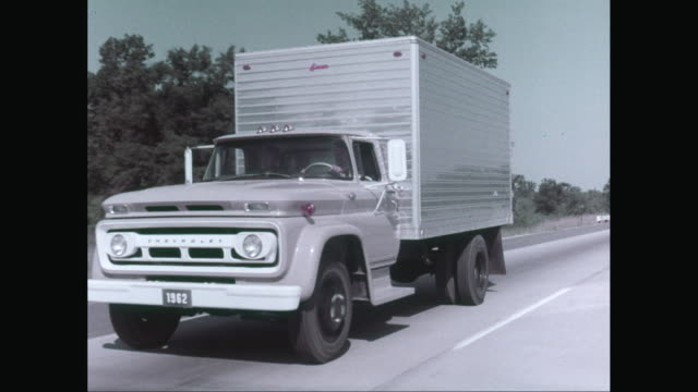 ws ts man driving 1962 heavy goods vehicle on street / united states - lastzug stock-videos und b-roll-filmmaterial
