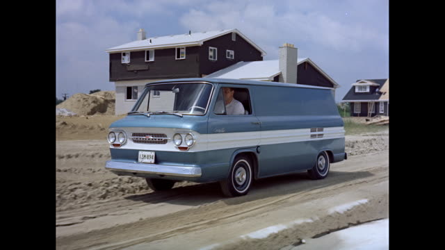 stockvideo's en b-roll-footage met ws ts man driving 1963 chevrolet van on road / united states - 1963