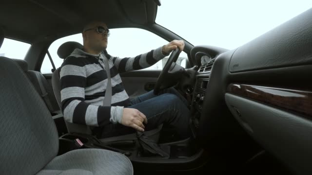 ld man driving a car and crashing - one mid adult man only stock videos & royalty-free footage