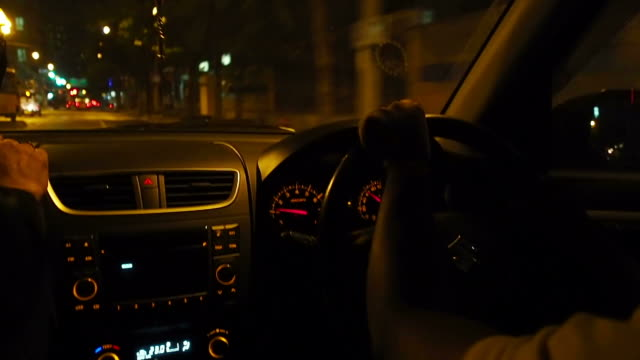 A man driving a car at night