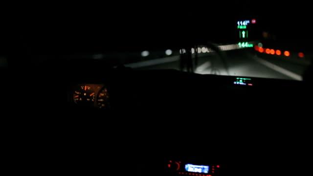Man driving a car at night