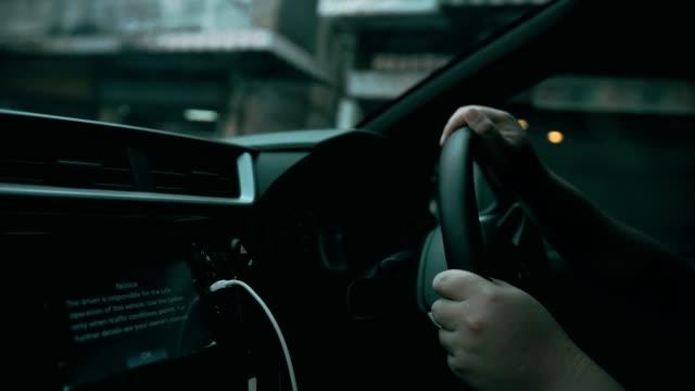 man driving a car - steering wheel stock videos & royalty-free footage