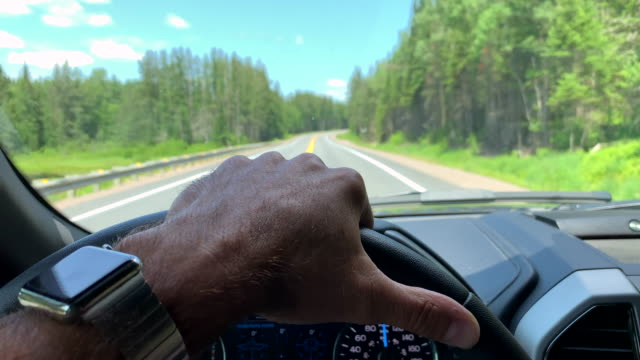 man driving a car while using smart watch - dashboard vehicle part stock videos & royalty-free footage