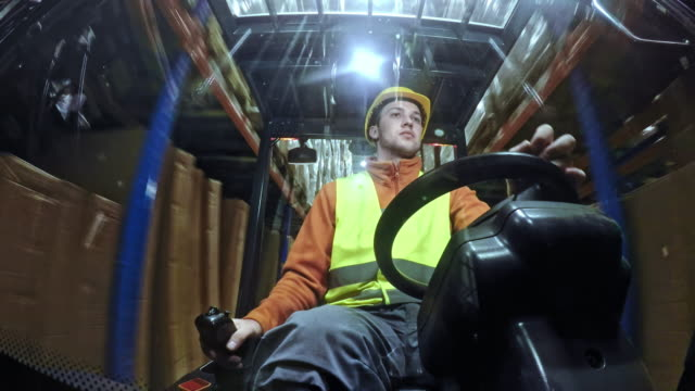 ld man driving a forklift in the warehouse - forklift truck stock videos and b-roll footage
