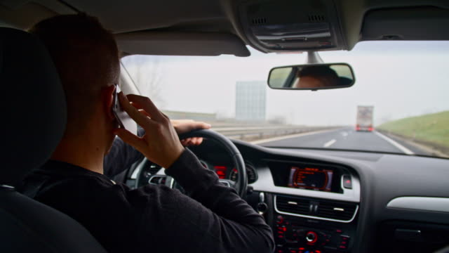 ms man driving and having a call - distracted stock videos & royalty-free footage
