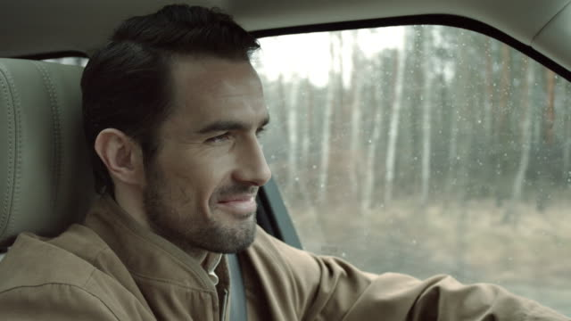 man driving and smiling - handsome people stock videos & royalty-free footage