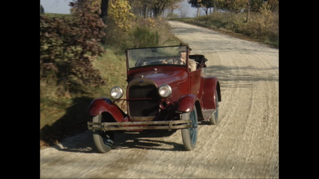 ws pov man driving antique car on country road / united states - on the move video stock e b–roll