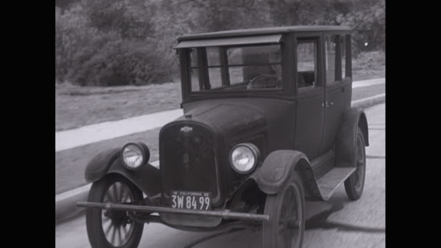 ms ts man driving antique car on road / united states - on the move video stock e b–roll