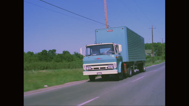 ws ts man driving articulated truck on road / united states - telegraph pole stock videos and b-roll footage