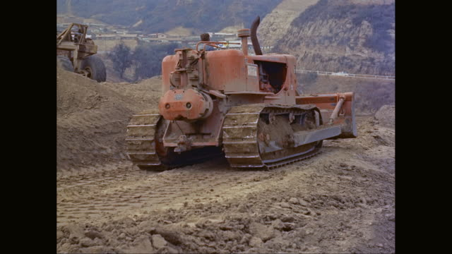 ws man driving bulldozer at construction site / united states - caterpillar track stock videos and b-roll footage