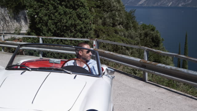 man driving cabriolet - collector's car stock videos & royalty-free footage