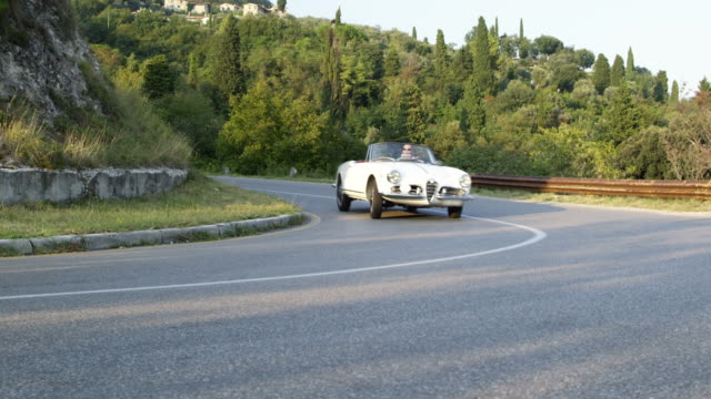 man driving cabriolet - collector's car stock videos and b-roll footage