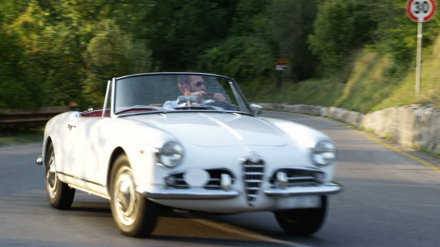 man driving-cabriolet - cabrio stock-videos und b-roll-filmmaterial