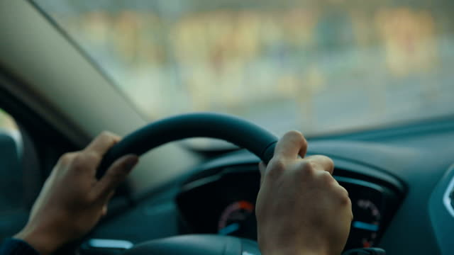 man driving car, holding steering wheel - vehicle interior stock videos and b-roll footage