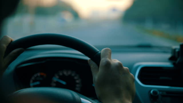 man driving car, holding steering wheel - moving past video stock e b–roll
