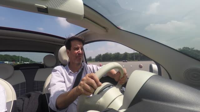 man driving car, POV man driving convertible at a motorway toll