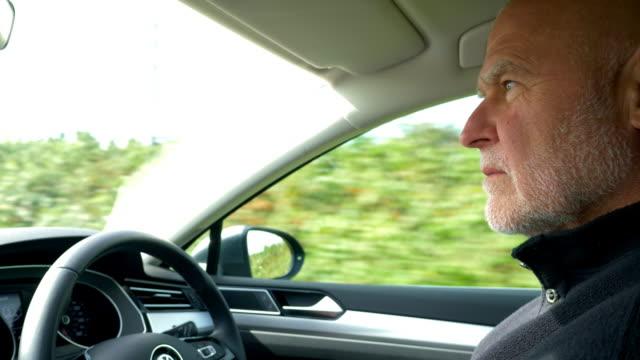 man driving car on country road. - hebriderna bildbanksvideor och videomaterial från bakom kulisserna