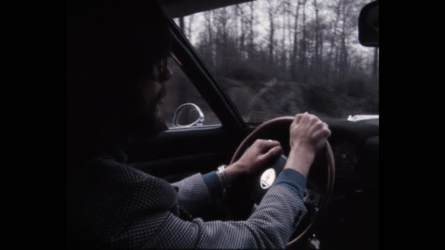 1979 man driving car on highway, new york state, usa - lenkrad stock-videos und b-roll-filmmaterial