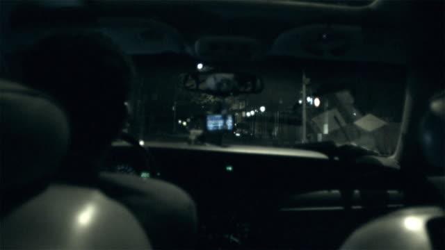 MS POV Man driving car through city street at night / New York City, New York, USA