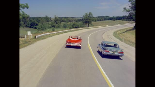 WS POV Man driving Chevrolet car on road / United States