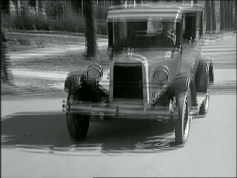 b/w 1926 reenactment man driving chevrolet on suburban street - chevrolet stock videos & royalty-free footage
