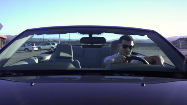 ms, man driving convertible car through desert, near san diego, california, usa - one mid adult man only stock videos & royalty-free footage