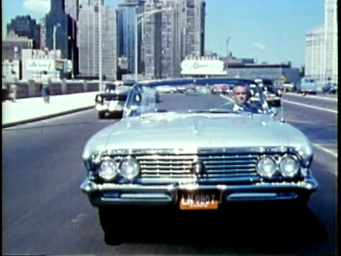 vidéos et rushes de 1963 montage ts man driving convertible on freeway / chicago, united states / audio - richesse