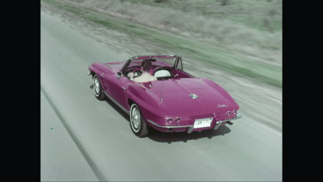ms pov man driving corvette car on road / united states - classic car stock videos and b-roll footage