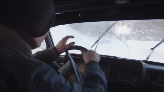 Man driving fast and drifting on snow during race