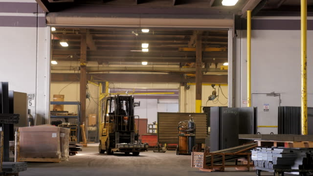man driving forklift in metal fabrication facility - metal blend stock videos and b-roll footage