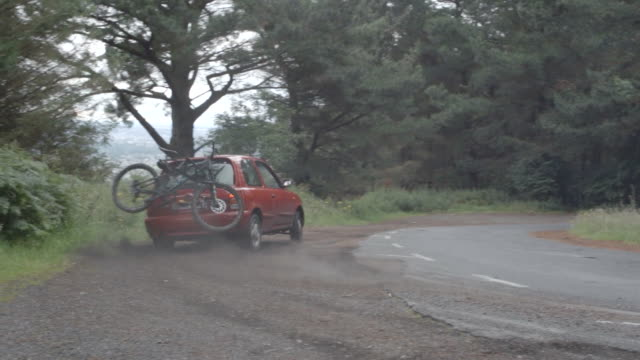 a man driving his red car with a mountain bike on the rack. - careless stock videos & royalty-free footage