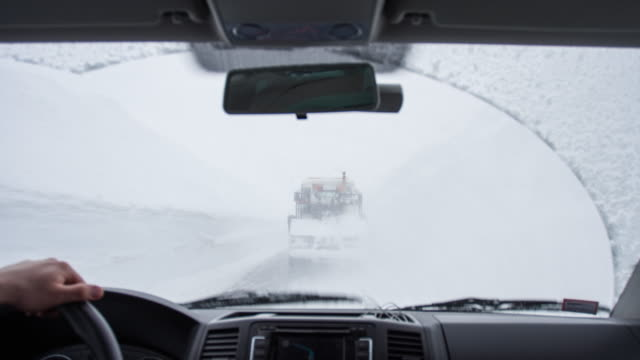 man driving in a snow storm - snowplough stock videos & royalty-free footage