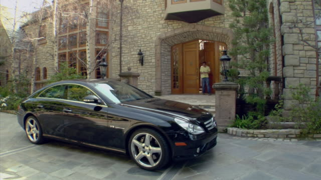 ms, man driving off in car parked outside front door of mansion, beverly hills, california, usa - grounds stock videos and b-roll footage