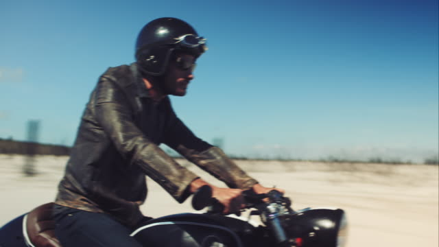 man driving on his motorcycle on highway - motorcycle biker stock videos and b-roll footage