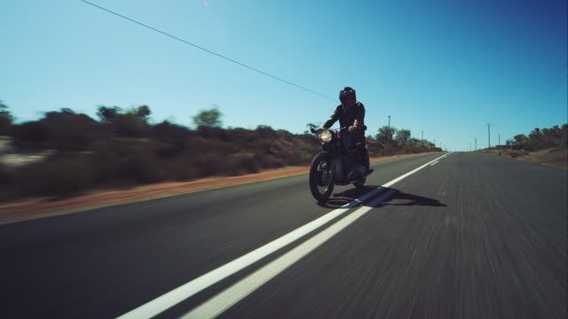Man driving on his motorcycle on highway