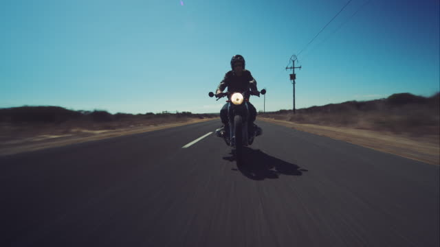 man driving on his motorcycle on highway - motorbike stock videos & royalty-free footage