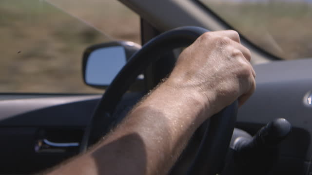 cu man driving opens car window to let fly out - hand stock videos & royalty-free footage